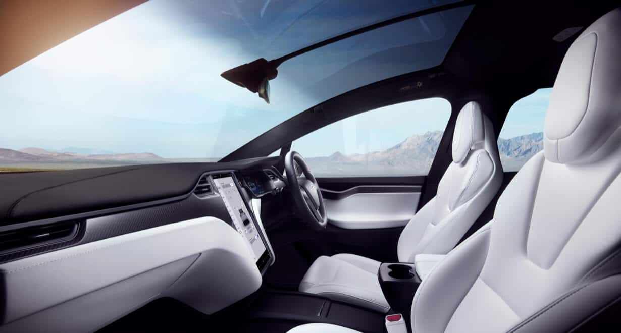 Panoramic windshield covering a white Model X interior
